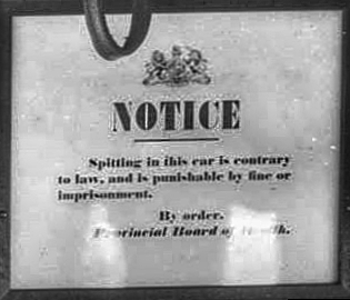 Cropped from CVA image LGN 1224 - Public notice posted to front bulkhead of streetcar 294, near the entrance to the motorman's vestibule. 1914