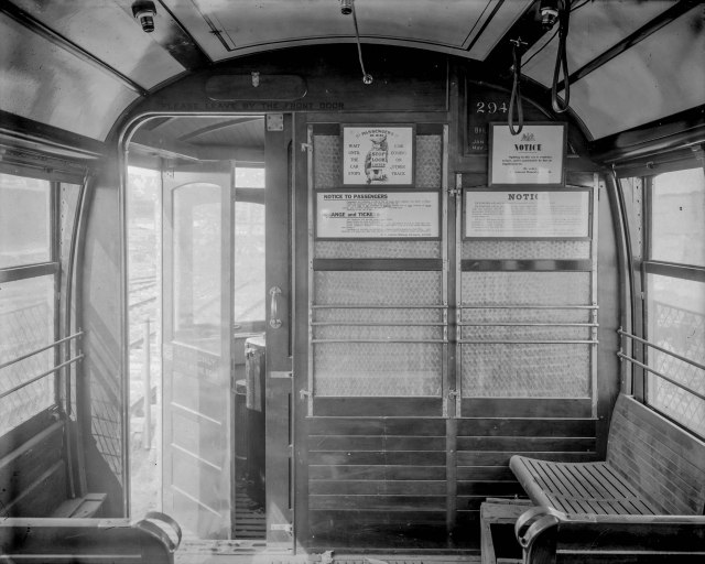 LGN 1224 - [Interior view of front bulkhead of streetcar number 294, showing posted signs and entrance to motorman's vestibule] 1914? bcer