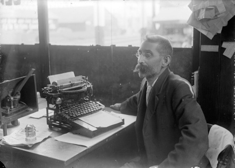 SGN 1552 - [James H. Field seated with caligraph typewriter at 99 Alexander Street branch of C.P.R. telegraph office], 1912,  C. Bradbury photo