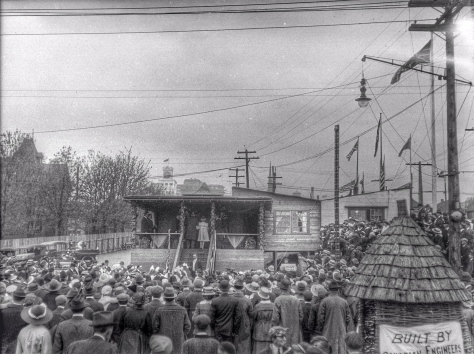 ca1918 CVA 260-1060 - [Crowds surrounding a building during a wartime carnival on the Cambie Street Grounds] Jms Crookall
