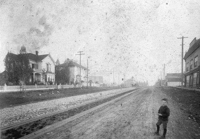 ca1893 Str P297 - [Westminster Avenue (Main Street) looking south from 6th Avenue] Photograph shows the residences of George W. Campbell and Dr. W.D. Brydone-Jack