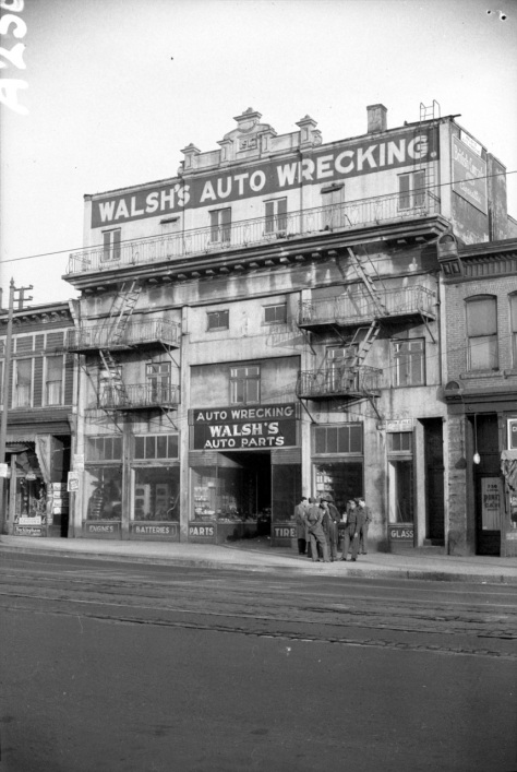 CVA 1184-189 - Exterior View of Walsh's Auto Wrecking on Main St. Showing Facade of Former Imperial Theatre. Jack Lindsay photo, 1943.