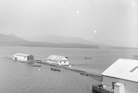 """CVA SGN-8 """"Swimming baths and boat rental floats in Burrard Inlet at the foot of Bute Street"""" Charles S. Bailey photo, 1890."""