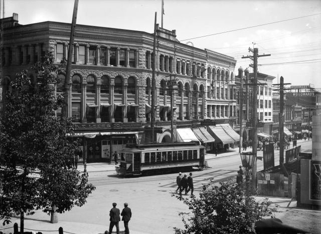 "CVA SGN-924: ""View of Buildings, Streetcars and Pedestrians at Hastings and Cambie Streets."" 1909."