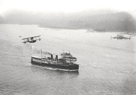 "CVA BoN120-2 ""Union Steamship Company Ship Lady Alexandra Entering First Narrows of Burrard Inlet"" [and biplane overhead] WJ Moore photo, 1924."