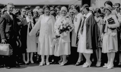 """CVA 99-2396: """"Arrival at Great Northern Railway Depot of Aimee Semple MacPherson (sic) on visit to Foursquare Gospel Tabernacle"""". 1930. Stuart Thomson photo. (Note: This image is a crop. For complete image, see CVA)"""