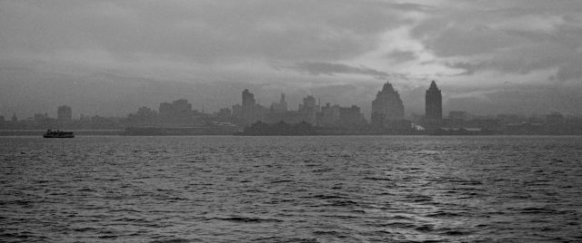 "CVA 260-205 ""Vancouver skyline at sunset from ship."" ca 1930. James Crookall photo."