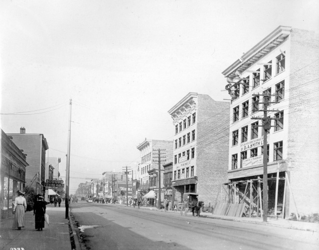 CVA M-11-55 - Buildings under construction on a retail street - Granville Street, between Smythe  (sic) and Nelson looking south, 190-?.