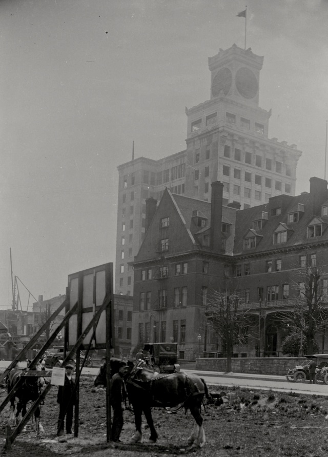 CVA SGN 1543 - [View of Georgia Street near Granville Street, showing Hotel Vancouver, and men with horses in empty lot]. 1912? C. Bradbury photo.