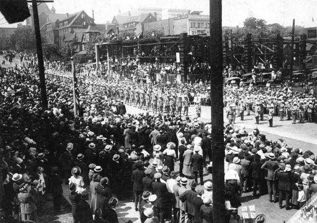 CVA Mil P64.3 - [Troops on parade on Burrard Street at Melville Street]. Between 1914-18. S Thomson photo.