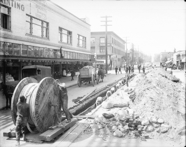 LGN 988 - [Men laying power cables under Smithe Street], 1914,  BCER.