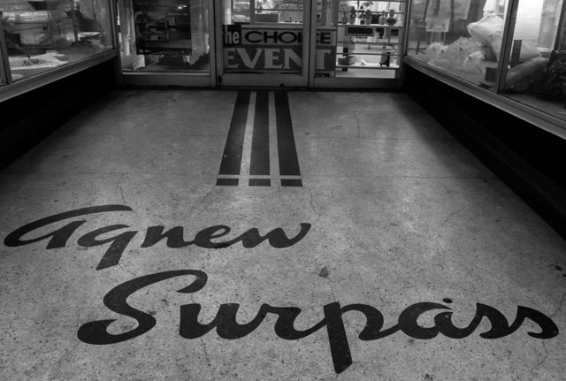 Agnew Surpass name still in approach to former shop. 2014. Author's photo.