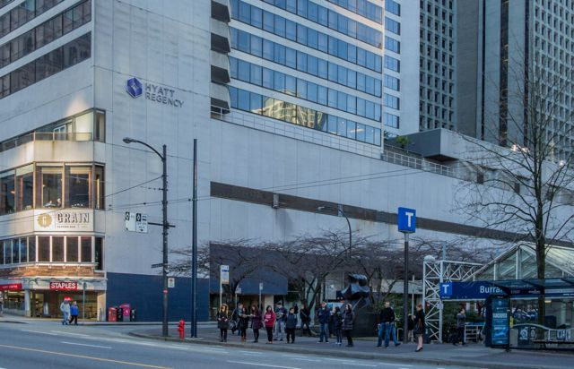 Looking southwest toward Burrard Skytrain Station (Burrard at Melville St.). Hyatt Hotel in background. 2015. Author's photo.
