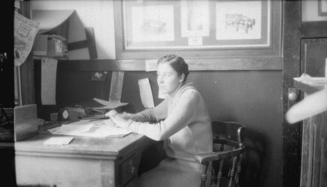 CVA 99-3087 - [Woman at desk] in Stuart Thomson's Office. ca1926. S. Thomson photo.