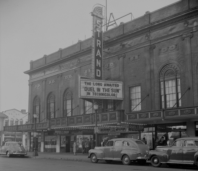 "CVA 1184-2315 - [Exterior view of the Strand Theatre (SE Corner Georgia @ Granville) showing advertising for the movie ""Duel in the Sun""], ca1948.  Jack Lindsay."