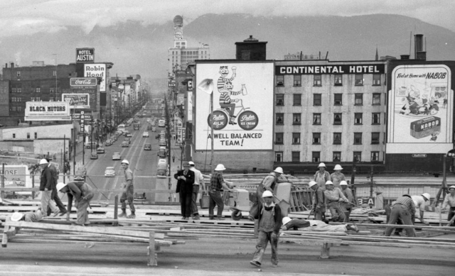 Detail of CVA 228-241 - Deck pour at junction of Howe, Granville north and Seymour. 1953. Lew Parry Film Prod'ns.