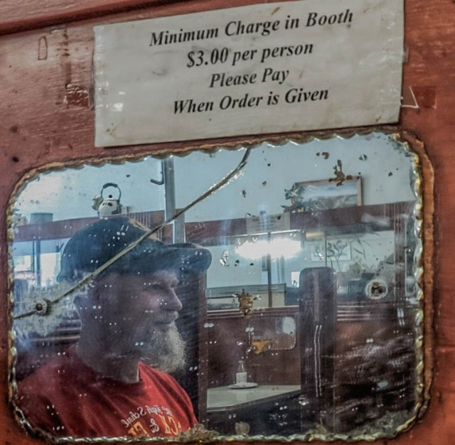 Inside The Ovaltine (Hastings near Main Street). All of the wooden booths have a (mainly chipped), charming mirror. 2014. Author's photo.