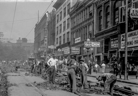 CVA SGN 1068.07 - [Men laying streetcar tracks at Hastings and Abbott Streets, for reconstruction of Hastings, Main, and Harris (Georgia) Street lines]. 1912?