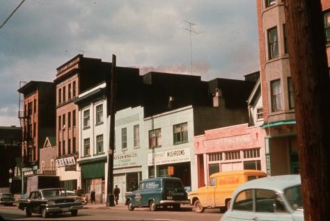 CVA: 1135-34 - Stores on 200 block East Georgia, 196- , William E Graham photo.,