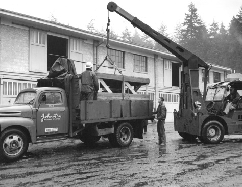 CVA: Mon P105.5 - [Crated statue of Lord Stanley being loaded onto truck at Johnston Terminals Limited] 1960. Williams Bros photo