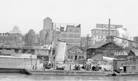 Detail/crop of CVA: Bo N34 - [H.M.C.S. Vancouver being dismantled at the Gulf of Georgia Towing Company on False Creek]. 1937. WJ Moore photo.