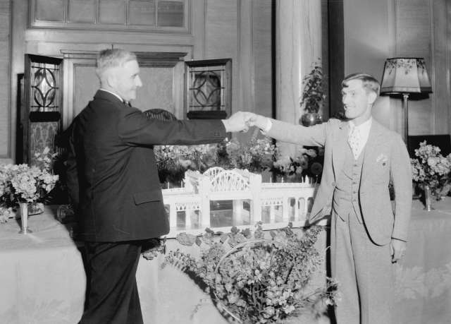 CVA 99-2722 - Eddie Peabody at Hotel Vancouver with Burrard Bridge cake, 1 July 1932. Stuart Thomson photo. Eddie is the one on the right. No idea who the gent is that he is clowning around with.
