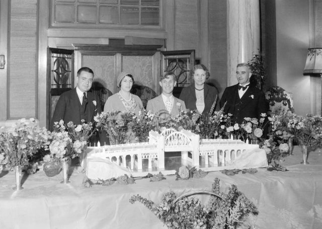 CVA 99-2723 - Eddie Peabody at Hotel Vancouver with Burrard Bridge cake, 1 July 1932.  Stuart Thomson photo,