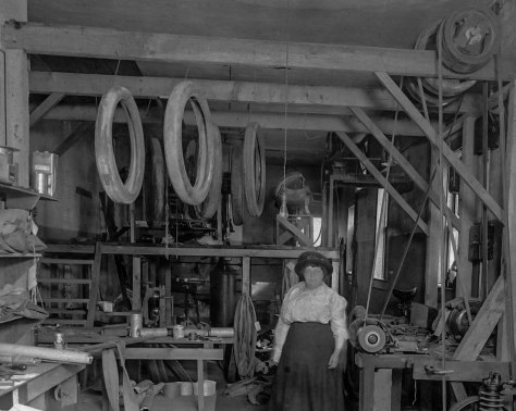 CVA: Bu P540 - [Interior of Nye's Automobile and Tire Repair shop - 2228 Cambie Street]. Florence Nye is pictured in what appears to be the vulcanizing dept.1920.
