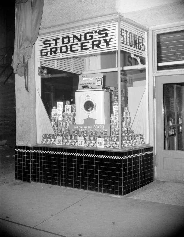 CVA 1184-1772 - [Burns' canned meat and Bendix washing machine display in the window of Stong's Grocery], 1940-48. Jack Lindsay photo.