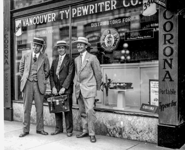 CVA 99-1532 - McDawson, three men in front of Vancouver Typewriter Co. [340 West Pender Street], ca1926. Stuart Thomson photo.