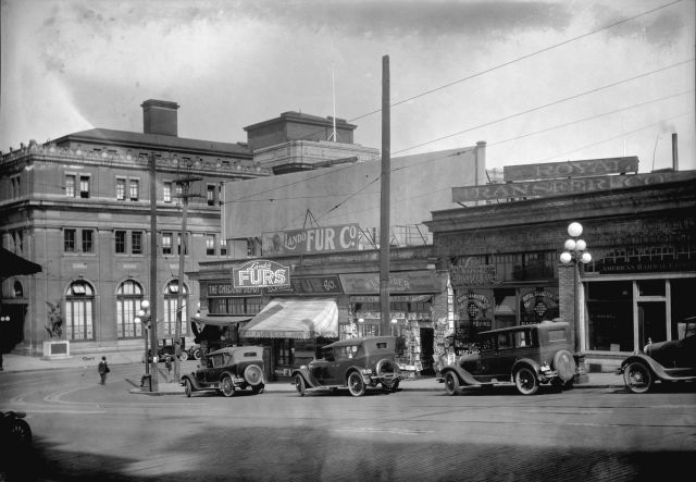 CVA 99-2262 - [View of shops in the 300 block Granville Street and C.P.R. Station at 601 Cordova Street West] taken for Duker and Shaw Billboards Ltd., ca1926. Stuart Thomson photo.