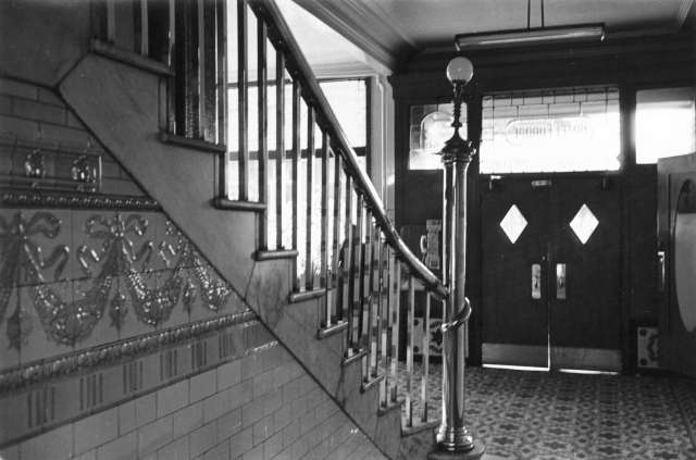 CVA 677-945 - [Front hall and stairway], Europe Hotel [43 Powell Street]. ca 1972. Art Grice photo.