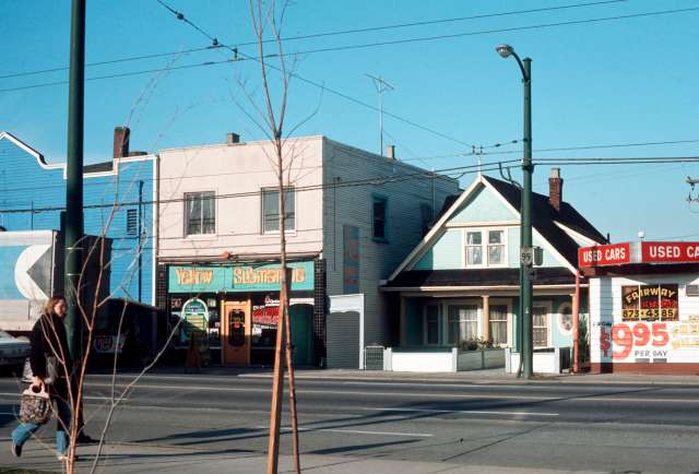 CVA 780-236 - [Yellow Submarine Records at] 319 East Broadway and [a house at] 323 East Broadway,  1975.