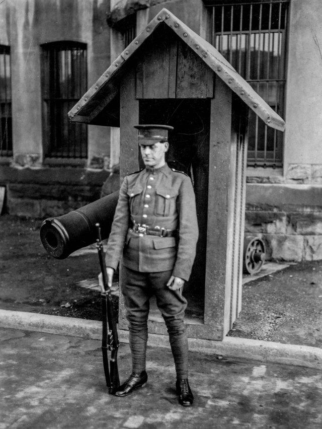 Mil P76 - [Sentry on duty outside Beatty Street Drill Hall], 1914-18.