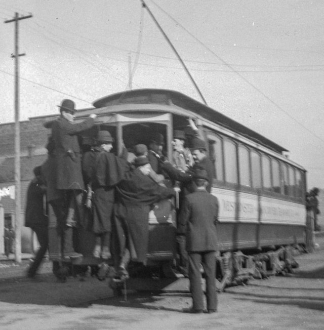 CVA: SGN 1085.2 - [People hanging on to back of streetcar at Hastings and Carrall Streets], 1896?  William M. Stark, photo