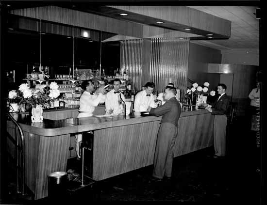 VPL 80597 Interior of Arctic Club and members.  1948. Artray studio.