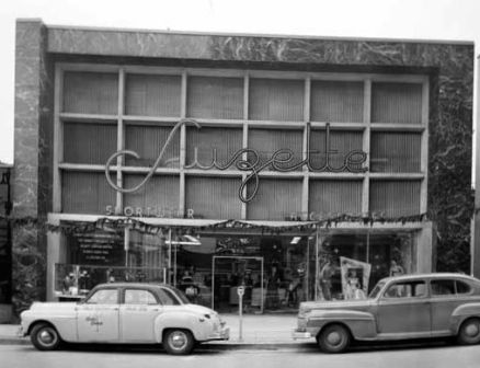 VPL 81119 - Suzette's Sportswear exterior at 660 Howe St. (Today, this is roughly where the Four Seasons Hotel and the mid-Howe St. entry to Pacific Centre Mall are located). 1949. Artray Studio.