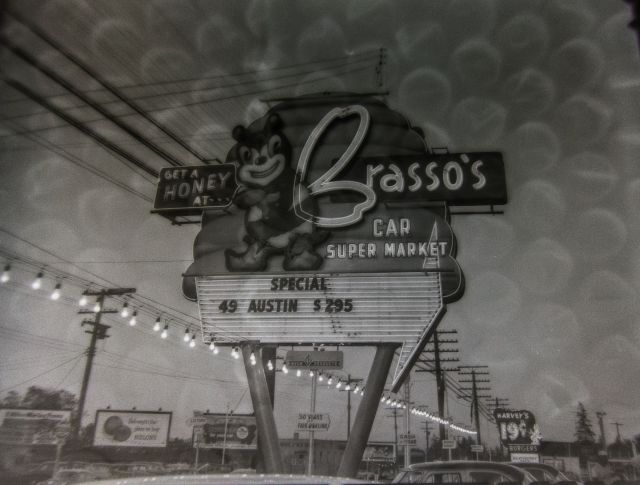 VPL 83053 Neon Signs, Ad Billboards, 3200 Block Kingsway Brasso's Car Supermarket, Harveys Burgers, Night and Day, 1956. Vic Spooner photo.