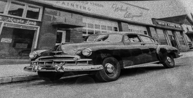 VPL 83858 - Series of Images of 1949 Chevrolet [Fleetside Deluxe Fastback], Pontiac, Oldsmobile automobiles parked in front of Colliers Ltd., 741 Homer Street. 1949. Tom Christopherson photo.