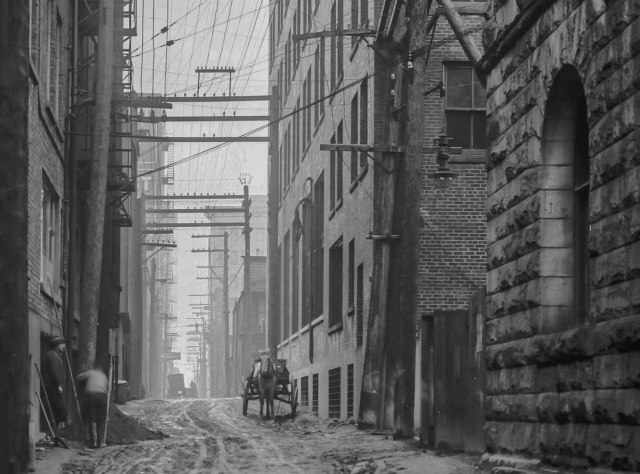 Detail of LGN 1130 - [Electric power lines running above lane east of Granville Street]. 1914. BCER.