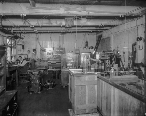 LGN 947 - [Men working in B.C. Electric testing lab, located above the car barn building on Main Street]. 1914? BCER photo.