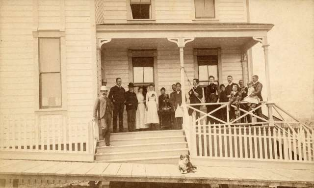 Bu P141 - [Group portrait on porch of the Ellesmere Rooms at 439 Homer Street (Man in derby hat identified as Frank M. Yorke)] ca 1890 Charles S Bailey photo.
