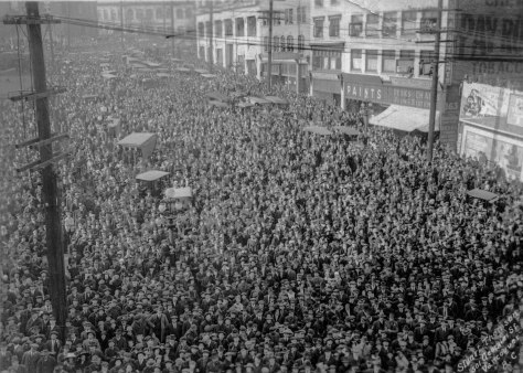 CVA - Bu P550 - [Crowd on Beatty Street observing Harry Gardiner (the 'Human Fly' scale the World Tower] 1918 Stuart Thomson photo. (Note: The original image seemed to be to be slightly over-exposed; adjustments have been made to this copy).