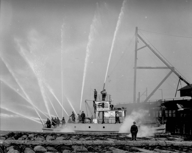CVA 99-1709 - %22J.H. Carlisle%22 fireboat test run 1928 Stuart Thomson photo. (Note- Carlisle the man is standing amidships upon Carlisle the fireboat)