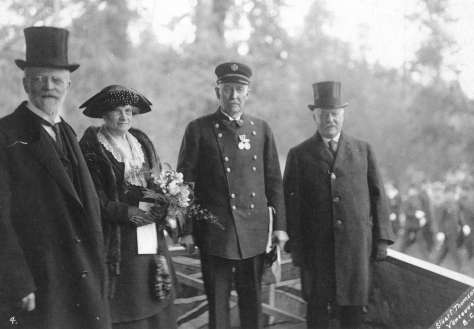CVA - Port P140 - [Former Fire Chief J.H. Carlisle after receiving the King's Police Medal from His Honour W.C. Nichol, Lieutenant governor of B.C.] April 1923 Stuart Thomson photo