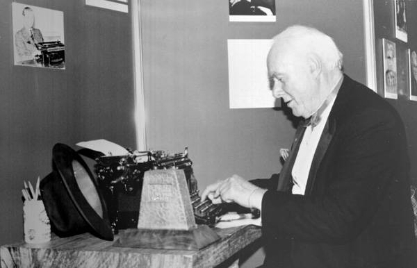 UBC Historical Photo Collection  Pierre Berton sits at typewriter at the Great Trekker dinner 1990 Larry Scherban photo