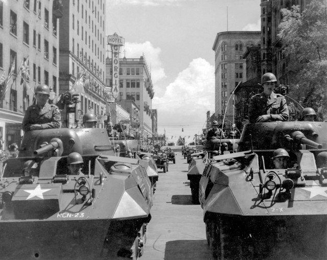 CVA 371-33 - [Military tanks and Jeeps travelling west on Georgia Street in the Diamond Jubilee Parade] 1946.