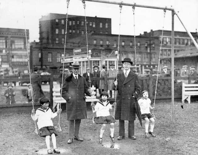 CVA 1477-69 - [Mayor L.D. Taylor with children and unidentified man at opening of children's playground at Carrall and Pender streets] 1928.