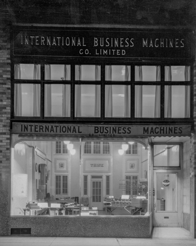 CVA 99-4954 - I.B.M. [International Business Machines Company store (515 West Georgia Street) at night] 1936 Stuart Thomson photo.