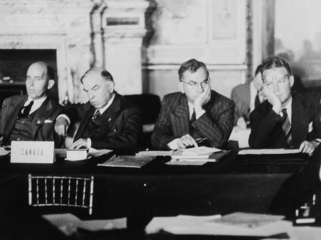 Norman R, WLMK, Brooke Claxton, Arnold Heeney 1 Aug 1946 at Paris Peace Conf., Palais du Luxembourgv Library and Archives Canada C-031312